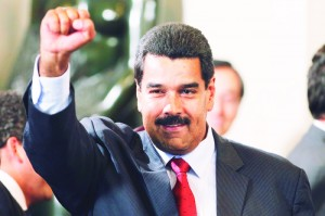 Venezuela's President-elect Maduro gestures after a meeting with presidents of the Unasur regional group in Lima