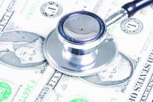 Stethoscope on money background of one dollar bills