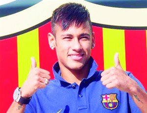 Neymar gestures after signing his contract with FC Barcelona, in front of their offices close to Camp Nou stadium in Barcelona
